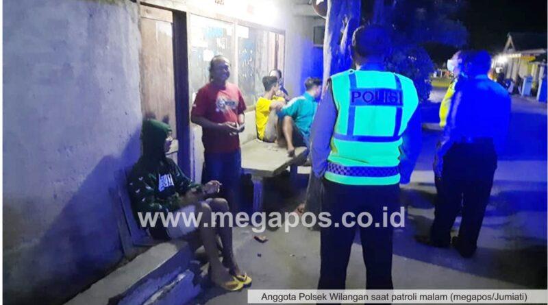 Patroli Malam, Polsek Wilangan Himbau Warga Patuhi Protokol Kesehatan Dengan Terapkan 4M